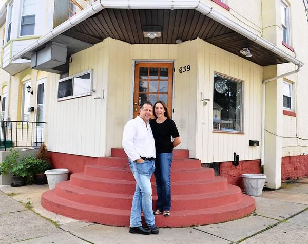 Billy and Yanna Kounoupis pose in front of their restaurant, Bethlehem Burger Bar, which is under construction. Kounoupis, owner of Billy's Downtown Diner, is planning to open a fast and casual burger restaurant in Bethlehem in late October at 639 Linden St.