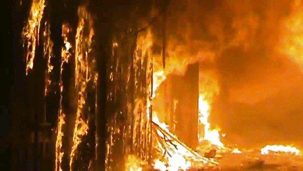A fire rages at the centuries-old bazaar, the Souk Madina, in Aleppo's Old City on Saturday. The image is taken from Shaam News Network video that has been authenticated based on its contents and other reporting.