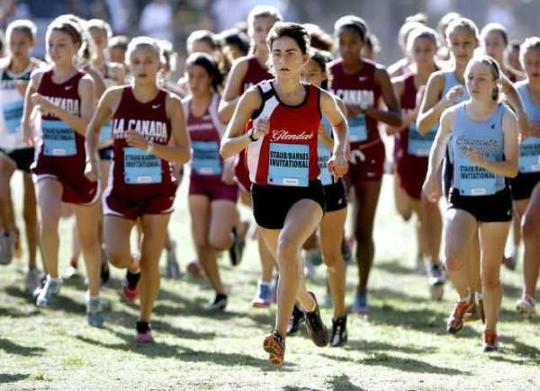 Glendale High's Leana Setian runs in the lead at the start of the Staub Invitational Girls Div. I Varsity cross-country race at Crescenta Valley Park in La Crescenta on Saturday, Sept. 29, 2012. (Raul Roa/Staff Photographer)