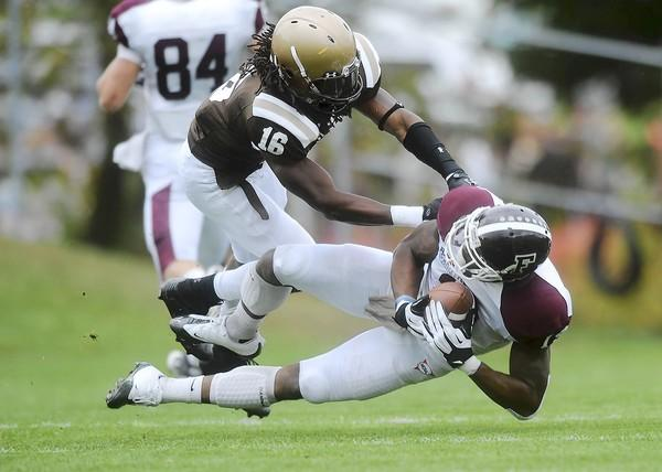 Lehigh's A.J. Visconti (top) tackles Fordham's Nick Talbert (right) in Goodman Stadium in Bethlehem Saturday afternoon September 29, 2012.
