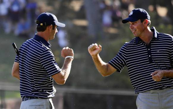 Team USA's Dustin Johnson and Matt Kuchar celebrate their skills on the 13th hole in the afternoon session.
