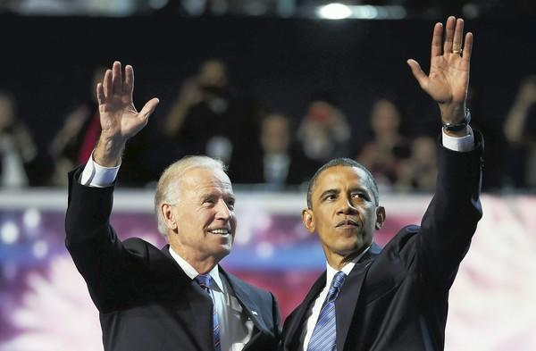 Democratic presidential candidate, U.S. President Barack Obama (R) and Democratic vice presidential candidate, U.S. Vice President Joe Biden wave after accepting the nomination during the final day of the Democratic National Convention at Time Warner Cable Arena on September 6, 2012 in Charlotte, North Carolina.