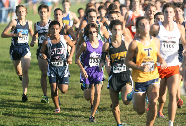Timber Creek's Brandon Marquez (3988) trails Trinity Prep's Daniel Salas (yellow) in the Boys Race of Champions at the 2012 FlRunners.com Invitational. Marquez finished 12th in the race with a time of 15:47.90.