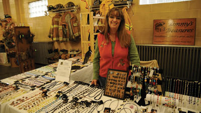 "Rockwood Resident Tammy Pyle stands in front of her hand-made jewelry booth, Tammy's Treasures, at the 5th annual Rockwood Fall Festival held by the Rockwood Volunteer Fire Department. Pyle has been a vendor at the festival since it started. ""It's important to support the local economy,"" Pyle said."