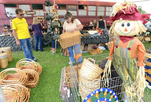 Steve Hess, left, and Lisa Ohm, both of Hancock, look at baskets from Back Home Trading Company located in Mifflintown, Pa, Saturday afternoon at Hancock Canal Apple Days.