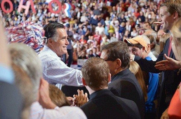 Mitt Romney greets supporters at a campaign rally this week in Toledo, Ohio. As his pivotal first debate with President Obama approaches, the Republican is struggling to reignite his campaign.