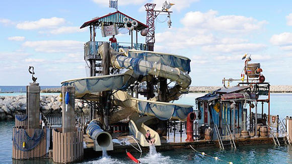 The Disney Dream cruise ship stops at Castaway Cay, which features a water play platform.