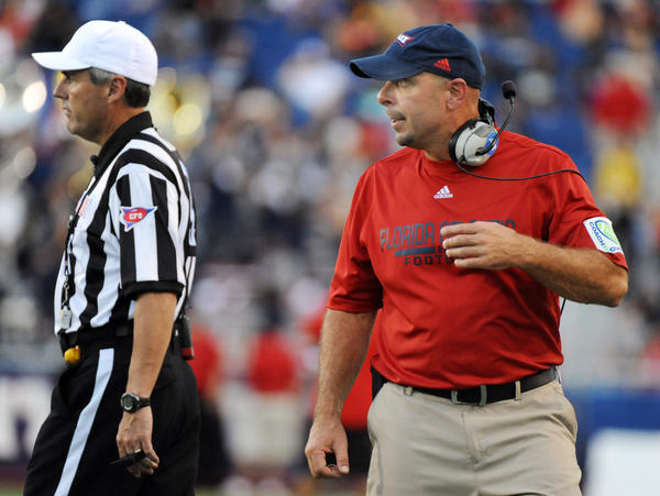 Florida Atlantic head coach Carl Pelini had a few words with the referees during the game against North Texas.