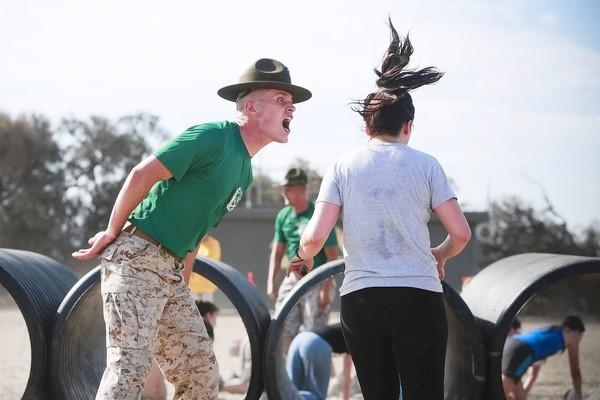 Marine drill instructor James Barnhill, left, loudly and affirmatively motivates a participant in the 11th annual Boot Camp Challenge in San Diego. Two thousand civilians vied for the bragging rights that come with completing a three-mile obstacle course designed for recruits at the boot camp here.