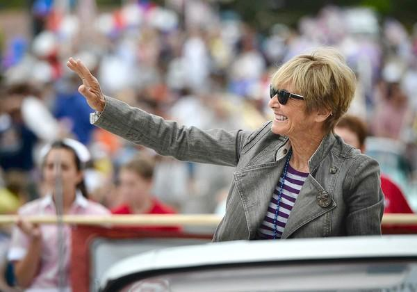 Newport Beach Mayor Nancy Gardner smiles as she wavies from the back of a convertible during the 19th annual Balboa Island Parade in June.