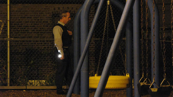 A Chicago Police Department detective inside Keystone Park, just north of North Avenue between Keystone and Pulaski on Wabansia.