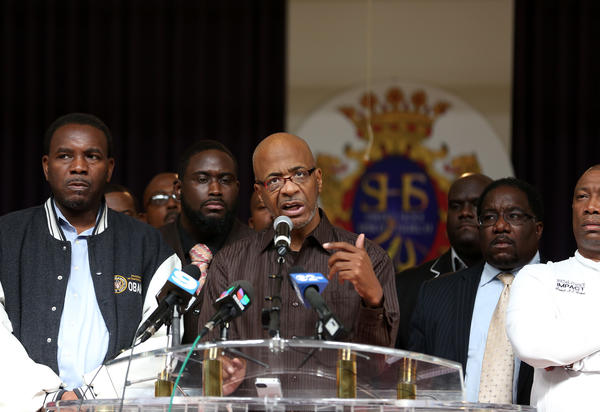 Bishop Larry Trotter (center, at microphone) and other other ministers hold a press conference on Sept. 10, 2012, where they asked for a resolution in the Chicago teachers strike.