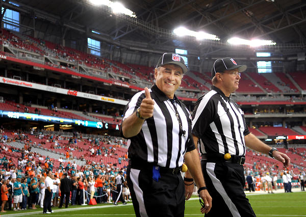 These NFL officials are happy to be back to work on a football field in Arizona.