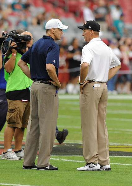 Head Coach Ken Whisenhunt of the Arizona Cardinals talks with Head Coach Joe Philbin of the Miami Dolphins during pregame at University of Phoenix Stadium