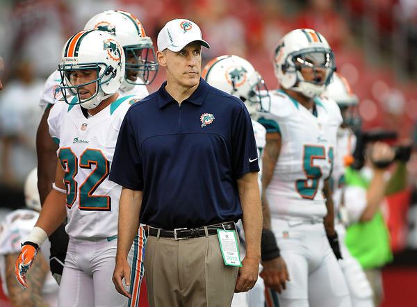Miami Dolphins head coach Joe Philbin watches his team during pregame warmups Sunday afternoon at University of Phoenix Stadium.
