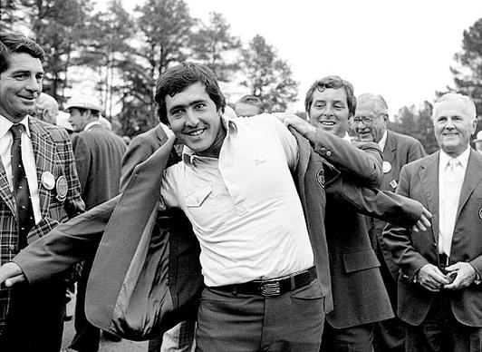 Seve Ballesteros, winner of the 1980 Masters title at the Augusta National Golf Club, receives the Green Coat from the previous year's winner, Fuzzy Zoeller.