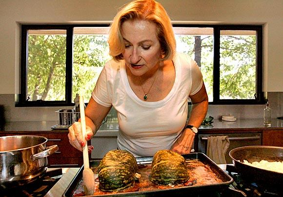 "At home in Ojai, ""Vegetarian Epicure"" author Anna Thomas roasts kabocha squash for a soup in her new cookbook."