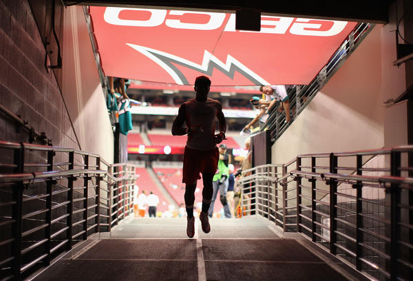 Cornerback Sean Smith #24 of the Miami Dolphins runs off the field before the NFL game against the Arizona Cardinals at the University of Phoenix Stadium.
