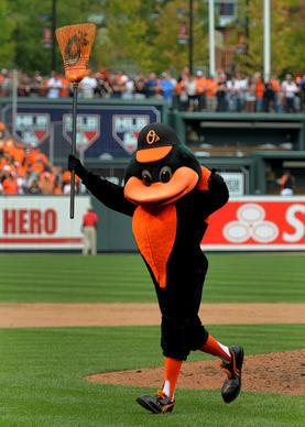 The Oriole Bird runs onto the field with a broom after the O's swept the Red Sox.
