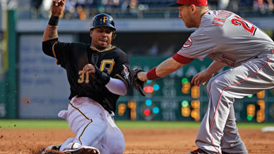 Cincinnati Reds third baseman Todd Frazier puts the tag on Pittsburgh Pirates' Jose Tabata at third during the ninth inning on Sunday. Tabata was attempting to go from first to third on an errant pick-off throw by Cincinnati Reds relief pitcher Aroldis Chapman. The Reds won 4-3.