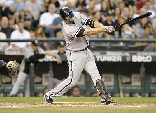 Paul Konerko hits a RBI single against the Mariners in the fourth inning.