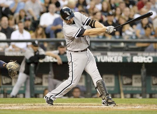 Paul Konerko hits a RBI single against the Mariners in t