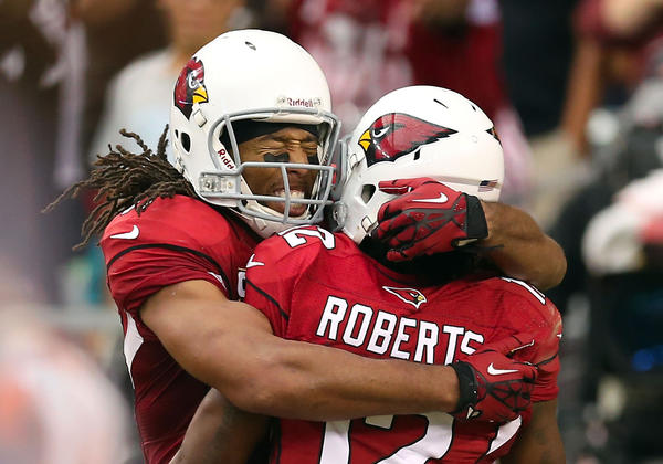Wide receiver Larry Fitzgerald #11 of the Arizona Cardinals celebrates with wide receiver Andre Roberts #12 after Roberts scored a 15 yard touchdown reception against the Miami Dolphins during the fourth quarter