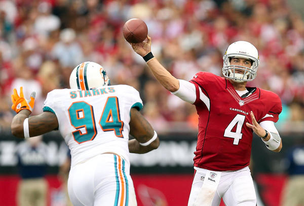Quarterback Kevin Kolb #4 of the Arizona Cardinals throws a pass over defensive tackle Randy Starks #94 of the Miami Dolphins.