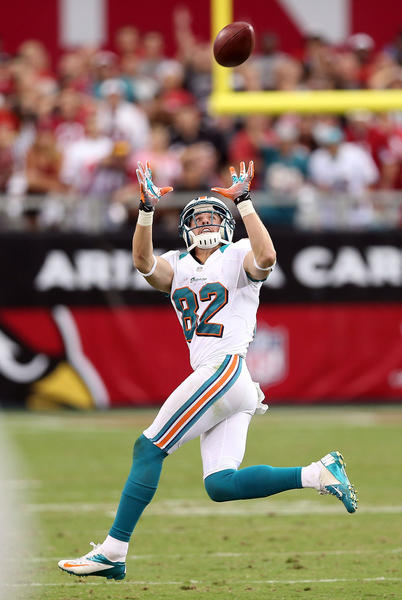 Wide receiver Brian Hartline #82 of the Miami Dolphins catches a 80 yard touchdown reception against the Arizona Cardinals during the fourth quarter