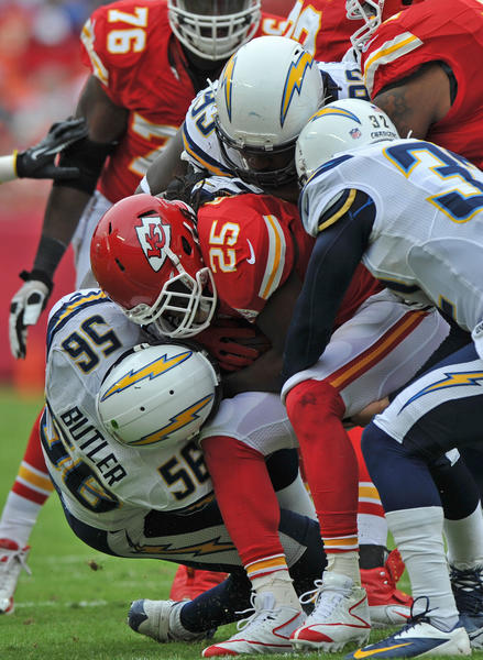 Defenders Eric Weddle #32, Shaun Phillips #95 and Donald Butler #56 of the San Diego Chargers wrap up running back Jamaal Charles #25 of the Kansas City Chiefs for a loss during the first quarter on September 30, 2012 at Arrowhead Stadium in Kansas City, Missouri. San Diego defeated Kansas City 37-20.