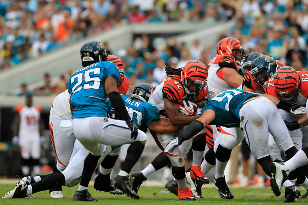 BenJarvus Green-Ellis #42 of the Cincinnati Bengals rushes against the Jacksonville Jaguars at EverBank Field on September 30, 2012 in Jacksonville, Florida. The final score was Cincinnati 27 and Jacksonville 10.