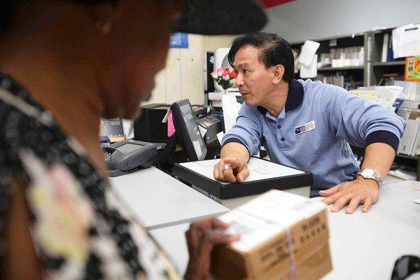Postal employee Raymond Tran is a big reason for the popularity of the Little Saigon post office branch in Westminster among those in the Vietnamese American community.