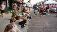 During the warmer months, crowds gather along brick-lined Seminary Street for First Friday festivities.