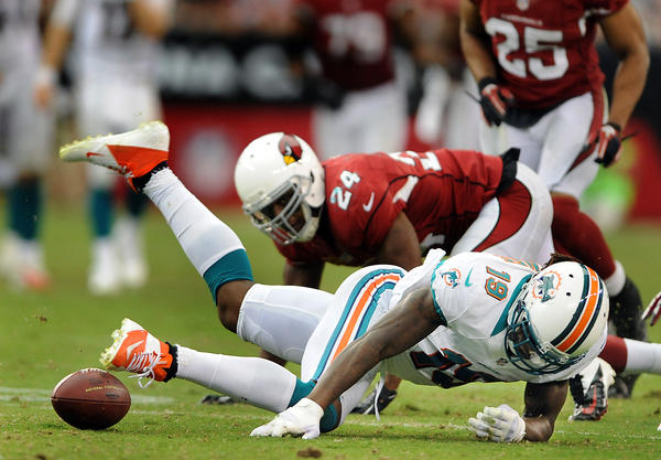 Miami Dolphins wide reciever Legedu Naanee fumbles the ball late in the fourth quarter and Arizona recovered it, which led to the Cardinals game-tying touchdown in the final minute of regulation play.