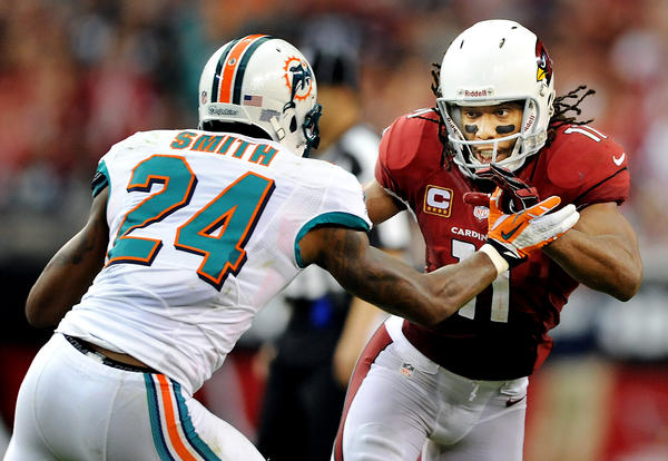 Miami dolphin's cornerback Sean Smith defends Arizona star reciever Larry Fitzgerald man for man.