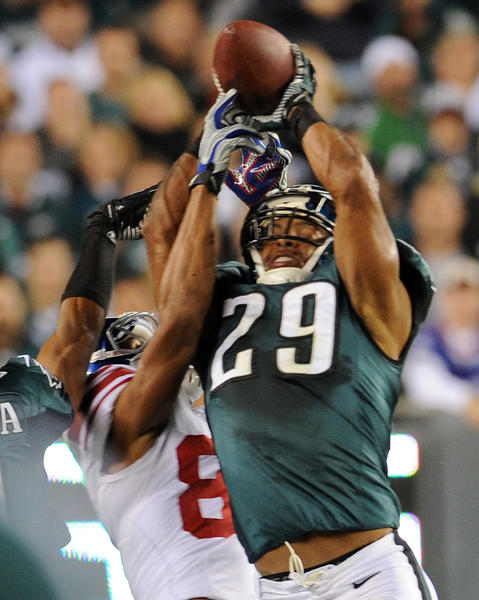 Philadelphia Eagles strong safety Nate Allen (29) and New York Giants wide receiver Domenik Hixon (87) go up for a pass  at Lincoln Financial Field in Philadelphia on Sunday.