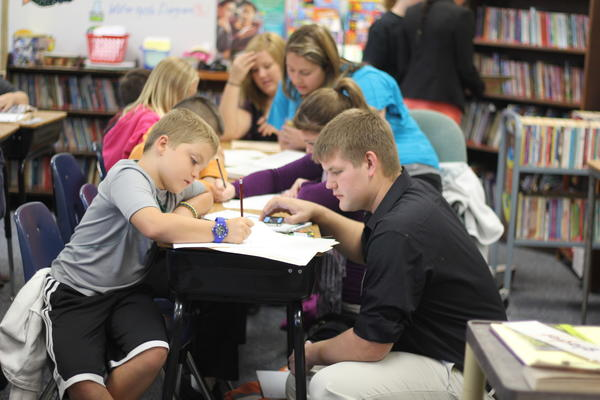 Nickolas Cunningham, right, begins work on an animal writing assignment as Northern student Justin Fox observes.