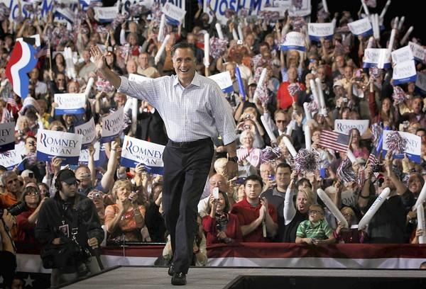 Mitt Romney arrives at a rally last week in Toledo, Ohio. Romney's initial response to the attack on the U.S. Embassy in Cairo was tarred as partisan, but he did not take advantage of a later opportunity to frame his critique within a larger criticism of President Barack Obama's Mideast policy.