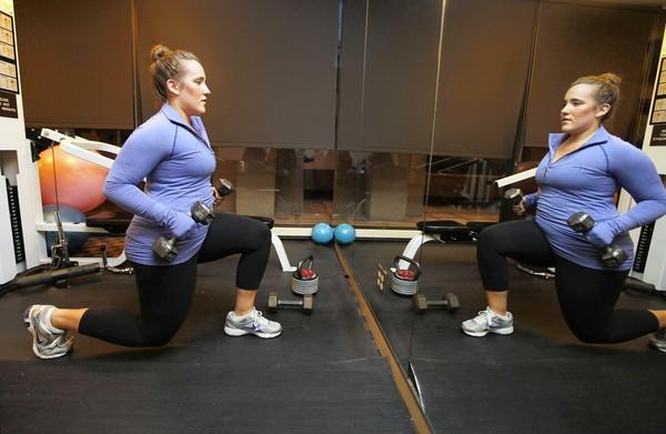 Lauren Brush works out in the gym in her apartment building in Chicago. She is one of many who have followed conventional weight-loss advice.