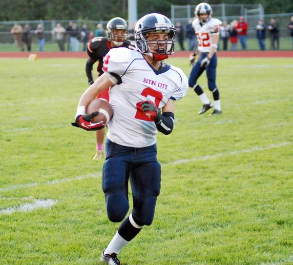 Boyne City running back Bradley Fouchia breaks into the open field Friday during the Ramblers' 43-0 Lake Michigan Conference win over East Jordan. Fouchia scored two touchdowns as Boyne improved to 6-0 and clinched its first playoff berth since 2009.