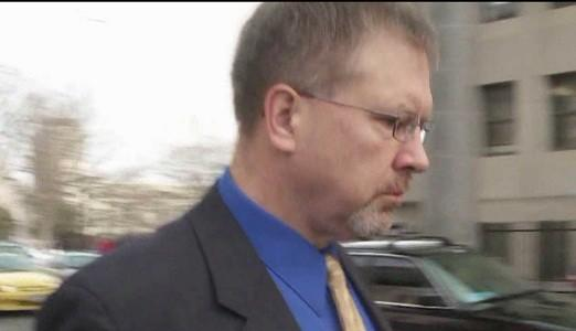 Robert Koistinen is charged with two counts of hindering prosecution for allegedly interfering with the investigation into a crash in which his son, also a Windsor Locks police officer at the time, hit and killed bicyclist Henry Dang, 15, on Oct.29., 2010