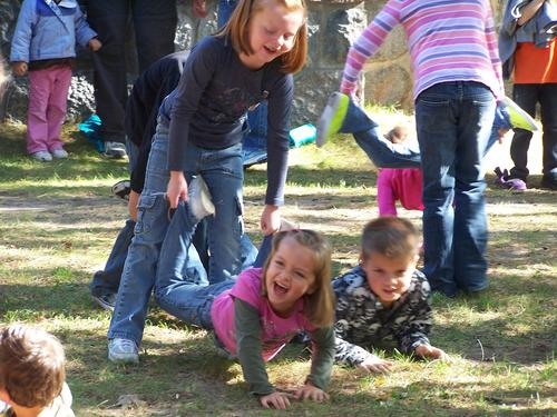 Sisters Madelinn (left) and Olivia Alwine couldn't stop giggling during the wheelbarrow races at Wilderness State Park Saturday during the park's annual fall festival.
