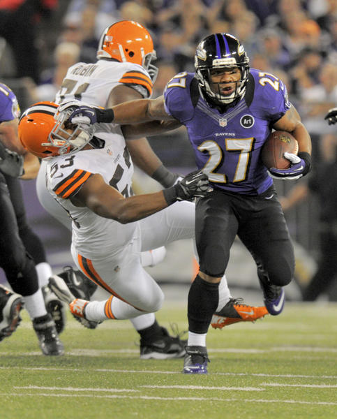 Ravens Ray Rice stiff-arms Browns defender #53 Craig Robertson, as Rice runs for a first quarter, first down. Baltimore Ravens Cleveland Browns in the first quarter.