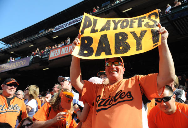 David Gibson from Brooklyn Park shows his Orioles support with a sign. Baltimore Orioles beat the Boston Red Sox at Oriole Park at Camden Yards with a score of 6-3.