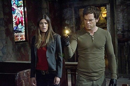 Jennifer Carpenter as Debra Morgan and Michael C. Hall as Dexter Morgan.