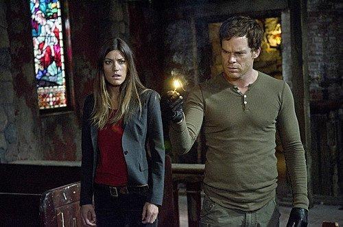 Jennifer Carpenter as Debra Morgan and Michael C. Hall as Dexter Morgan.