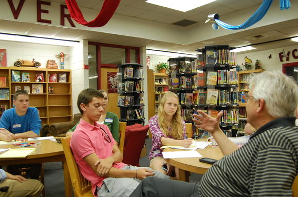 .Local students, from left, Russell Meurer, Cathryn Ellis, Emma Jackson and Miles Littlefield listen to John Nelson, executive editor for Advocate Communications Inc., right, talk Sunday about interviewing skills.