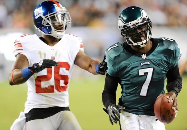 Eagles quarterback Michael Vick narrowly avoids being sacked by the New York Giants #26 Antrel Rolle at Lincoln Financial Field in Philadelphia on Sunday, September 30, 2012.