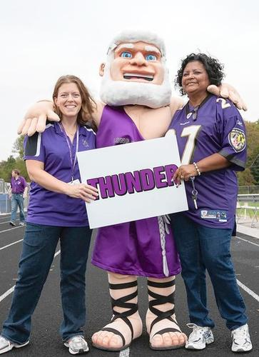 "From left, Jen Whiddon, the mascot Zeus, and Beetle Rice, pose for a shot together after the pep rally. Long Reach High School had a pep rally Friday, September 28 at the football field where they unveiled their new mascot ""Zeus."""