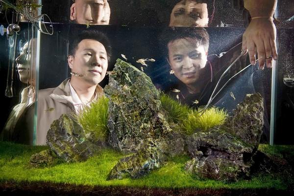 Steven and George Lo prune their tank